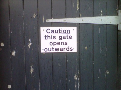 Odd gate sign illustrating article on copywriting