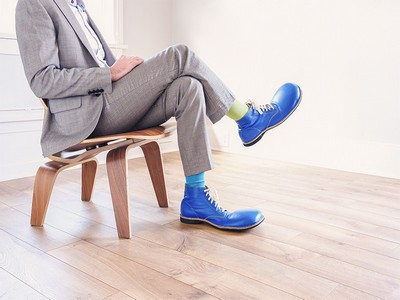 Photo of man wearing clown shoes for copywriting blog